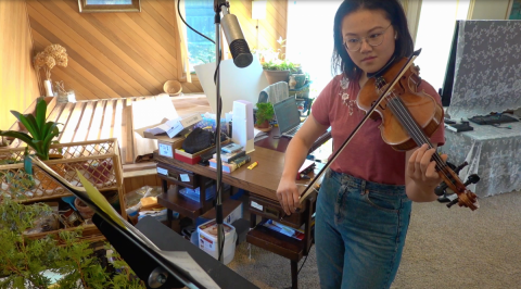 Yilin Huang recording her violin part at home for the opening musical piece of Skule Nite 2T1